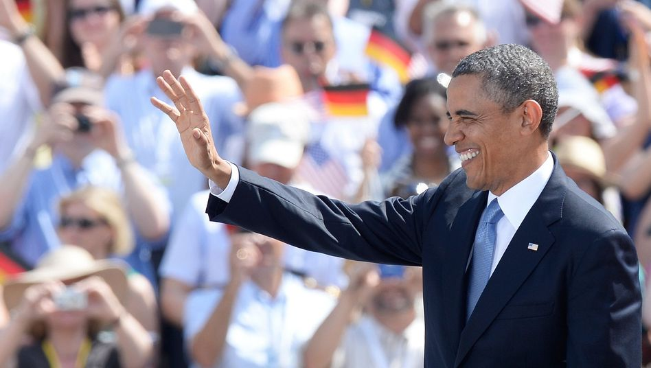 Charm offensive: US President Barack Obama waves after speaking at the Brandenburg Gate in Berlin.