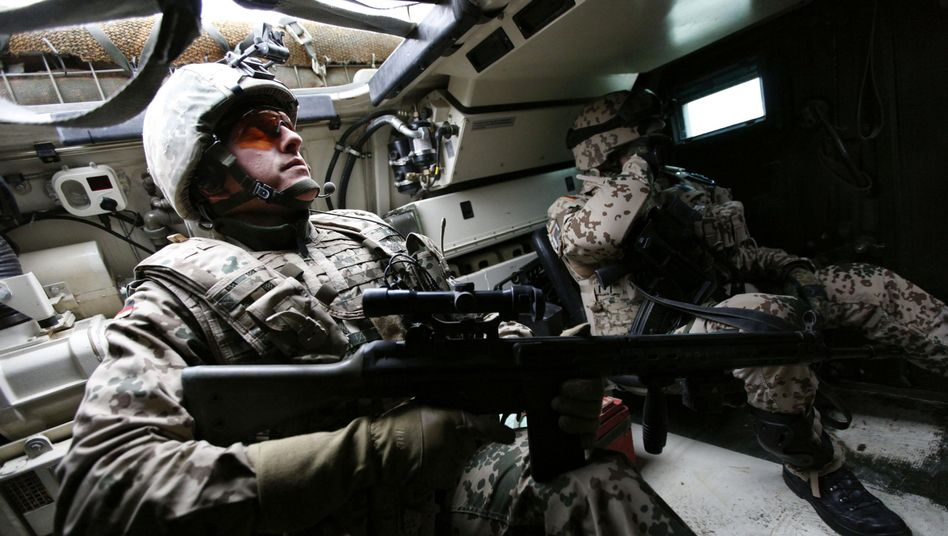 Bundeswehr soldiers on patrol inside a Fuchs armoured vehicle on the outskirts of Mazar-e-Sharif: German forces have been criticized for putting too much emphasis on their own safety.