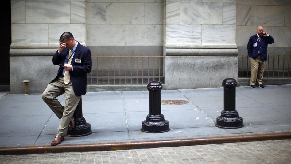 The financial crisis has led to a decline in American economic supremacy. Here, two traders taking a break on Wall Street in March.