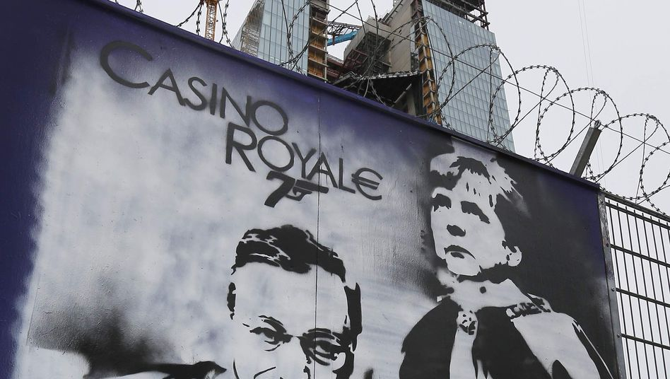 A graffito showing ECB head Mario Draghi and German Chancellor Angela Merkel outside the construction site of the new bank headquarters in Frankfurt.