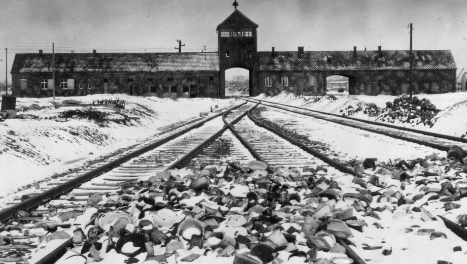 "An undated photograph showing Auschwitz-Birkenau's main guard house, which prisoners called ""the gate of death."""