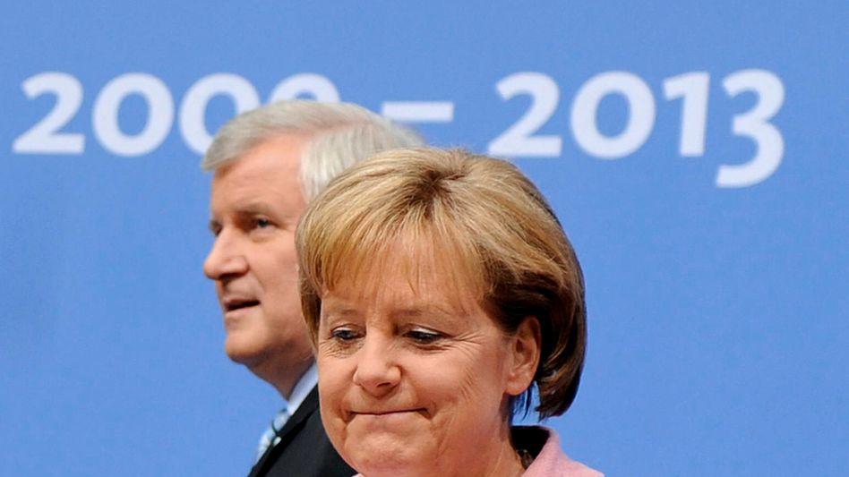 "Angela Merkel, Horst Seehofer (im Juni 2009): ""Verdichtung des Regierungsprogramms"""