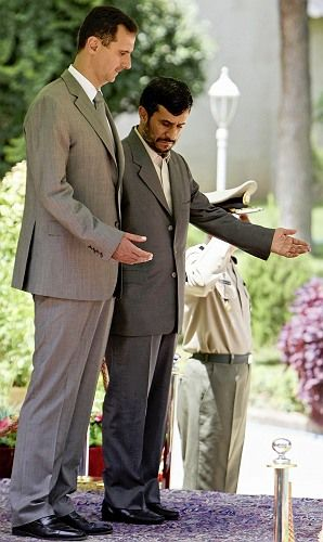 """Assad and Iranian President Mahmoud Ahmadinejad during a visit in Tehran on August 3, 2008: """"Good relations with Washington cannot mean bad relations with Tehran."""""""