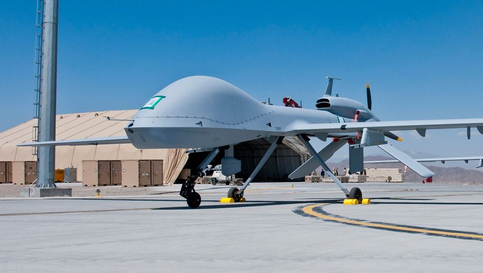 Two Grey Eagle drones on the tarmac in Afghanistan.