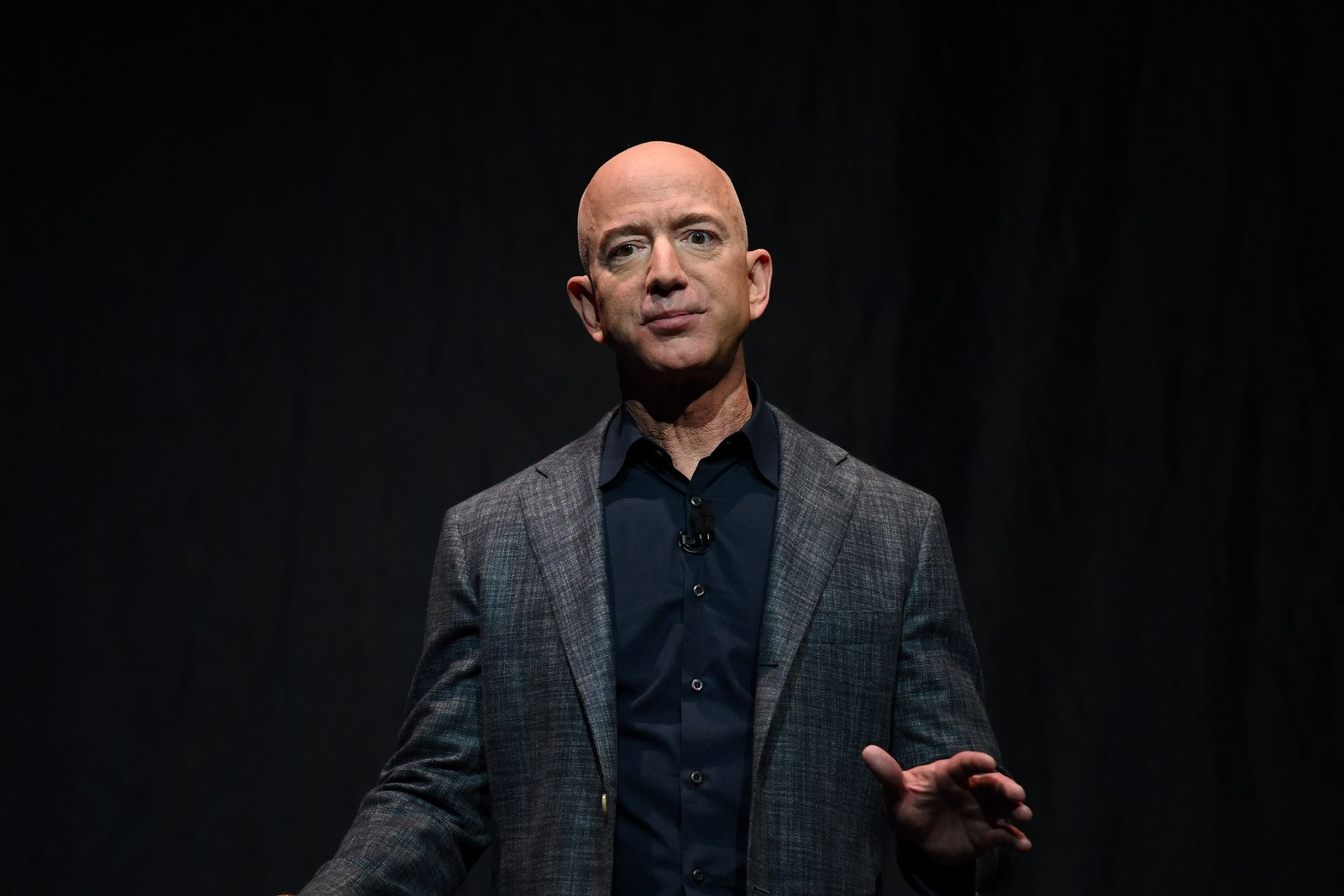 FILE PHOTO: Founder, Chairman, CEO and President of Amazon Jeff Bezos speaks during an event about Blue Origin's space exploration plans in Washington