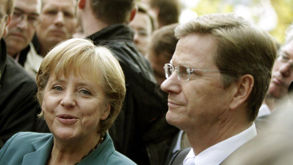 CDU-Chefin Merkel, FDP-Chef Westerwelle: Verhandlungsspurt für die Blitzkoalition