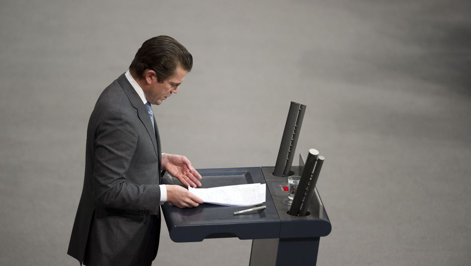 German Defense Minister Karl-Theodor zu Guttenberg faced a parliamentary grilling on Wednesday.