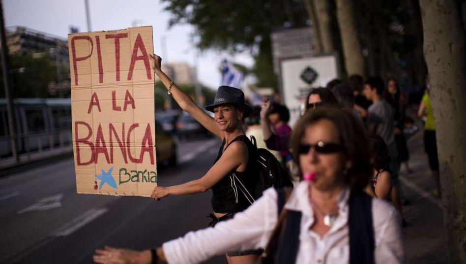 Demonstranten in Spanien: Zinsen für Staatsschulden steigen
