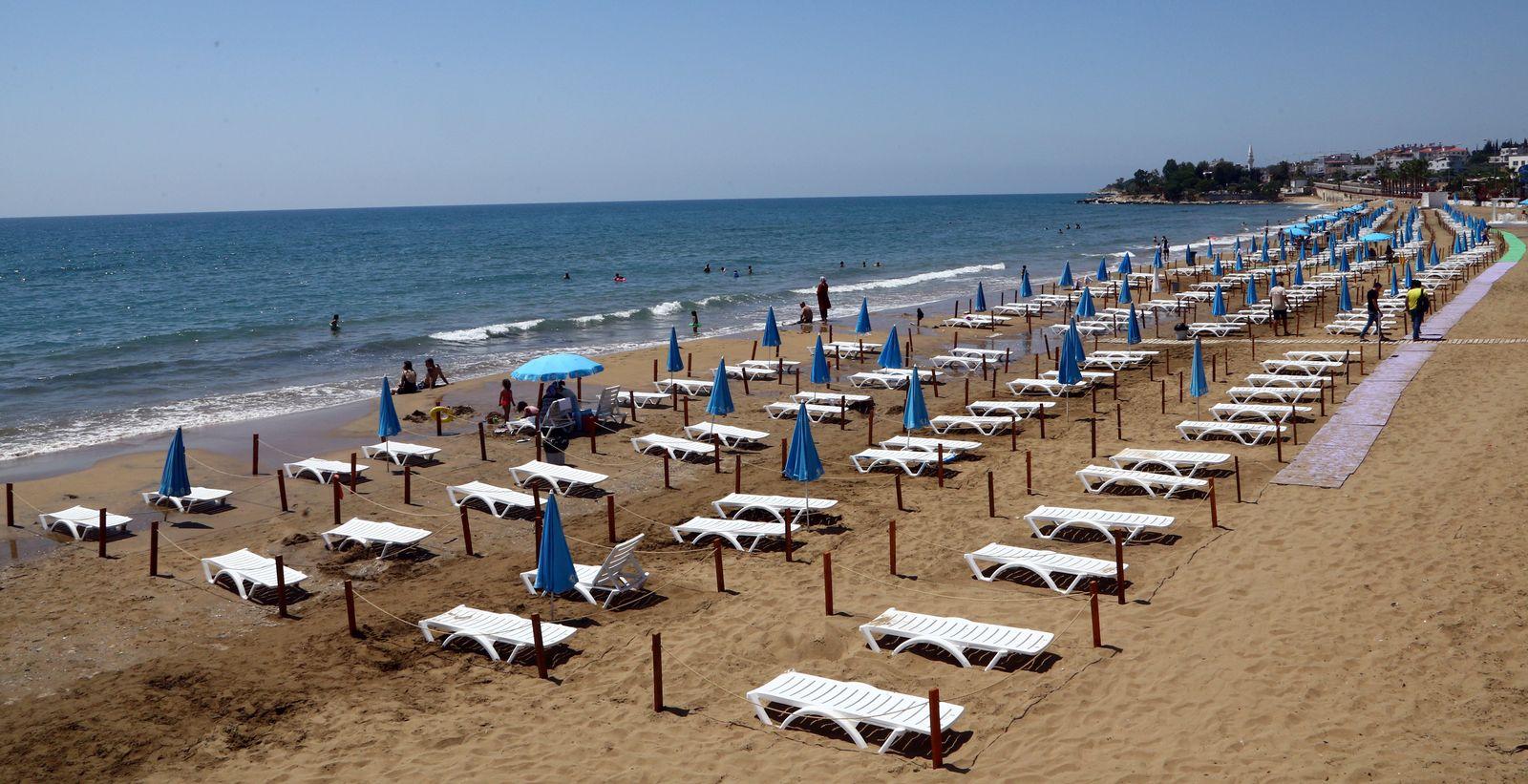 Sunbeds are aligned respecting social distancing on the Yemis Kumu beach near Mersin