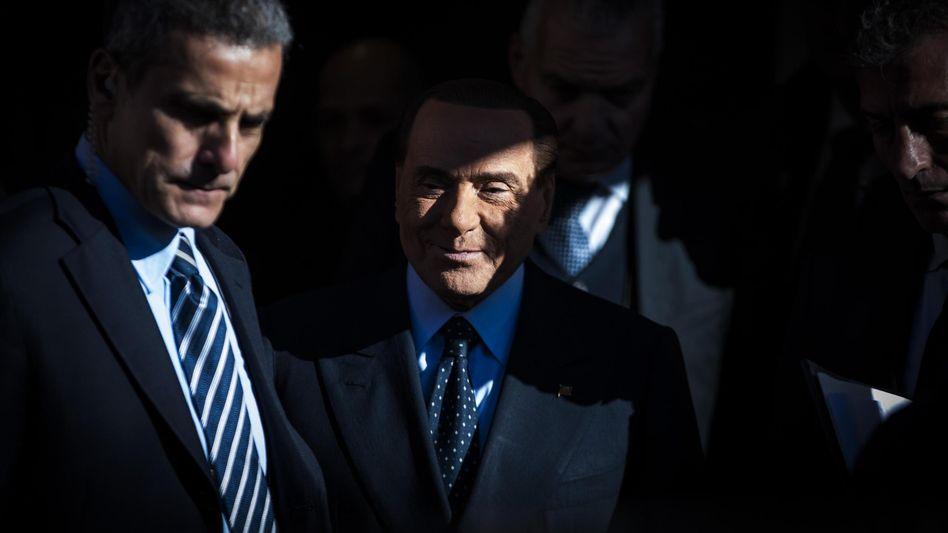 Silvio Berlusconi (.)