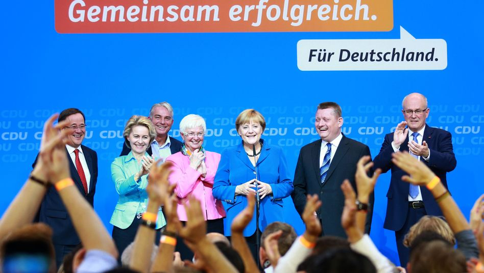 Four more years: German Chancellor Angela Merkel won a massive victory in Sunday elections.