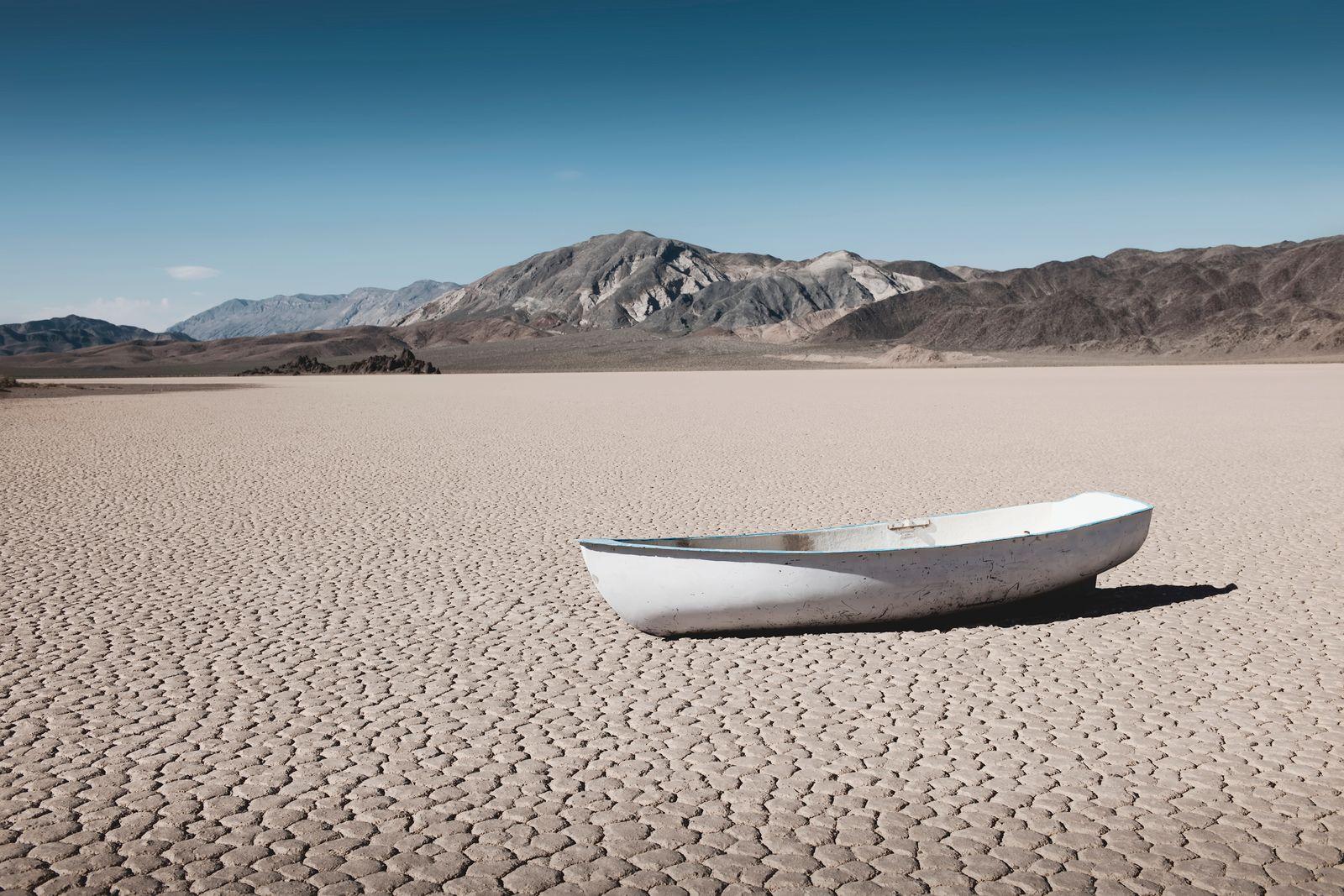 Empty boat in dry desert field