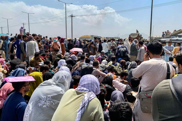 People gathered at the airport in Kabul hoping to leave the country