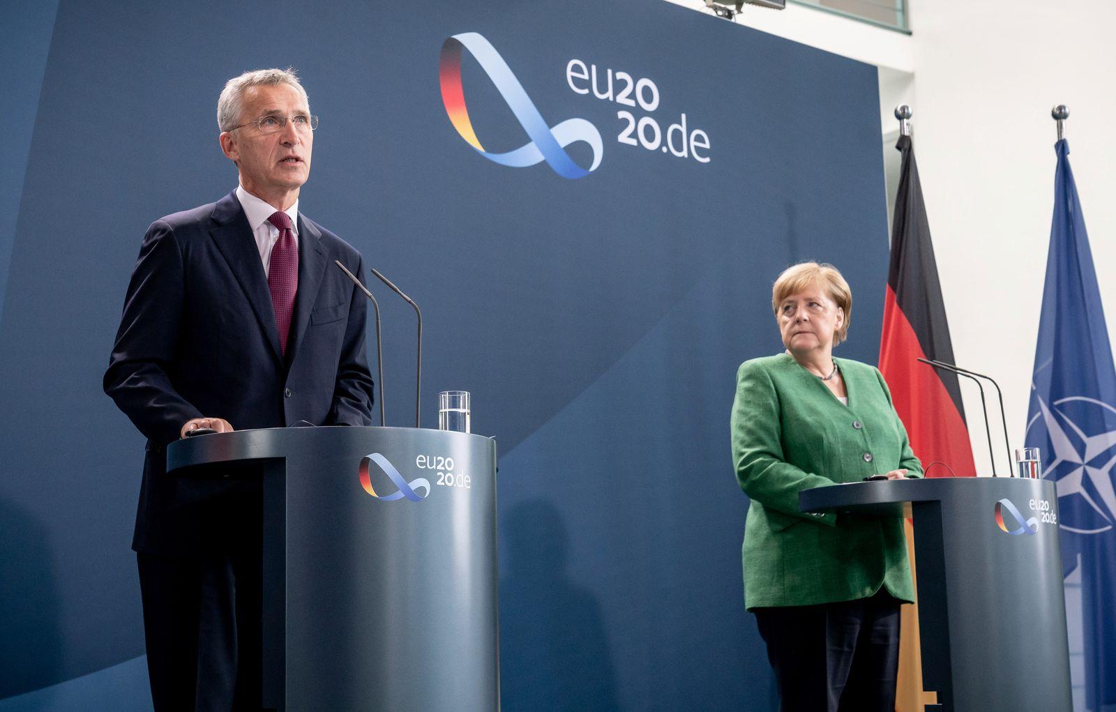 German Chancellor Angela Merkel and NATO Secretary General Jens Stoltenberg speak to reporters at chancellery in Berlin