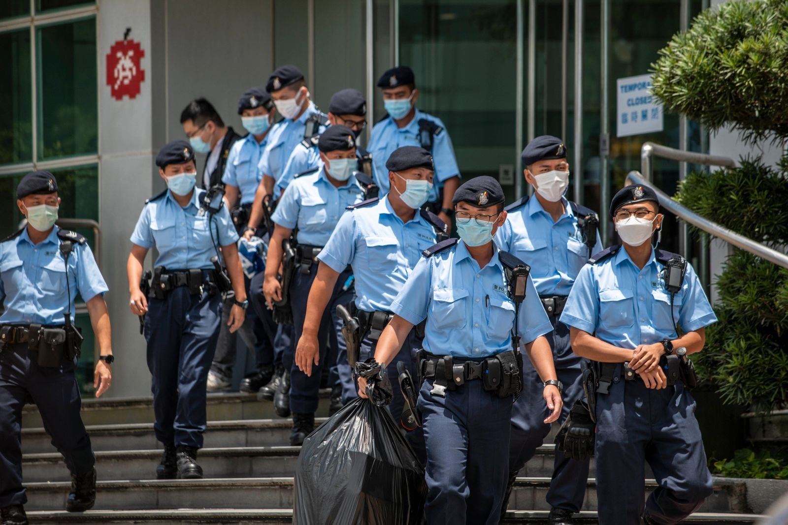 Hong Kong Police Arrests Top Apple Daily Staff Using Security Law Police Officers are seen leaving the headquarters of