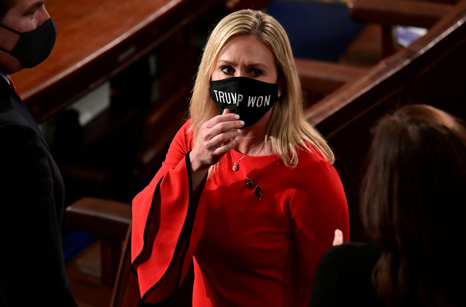 """FILE PHOTO: U.S. Rep. Marjorie Taylor Greene (R-GA) wears a """"Trump Won"""" face mask as she arrives to take her oath of office as a member of the 117th Congress in Washington"""