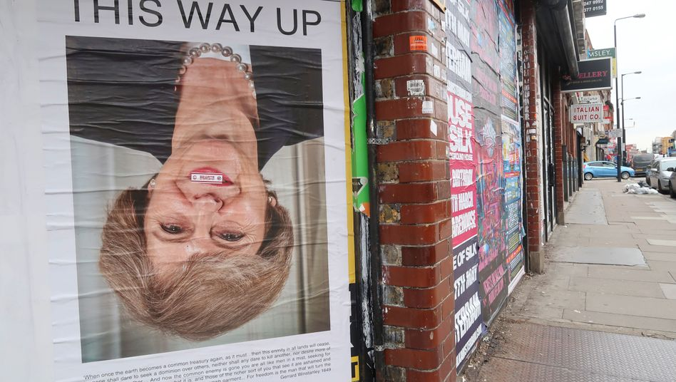 A poster of Theresa May: Few believe the Brexit problem will be easier to solve once the British prime minister is out of office.