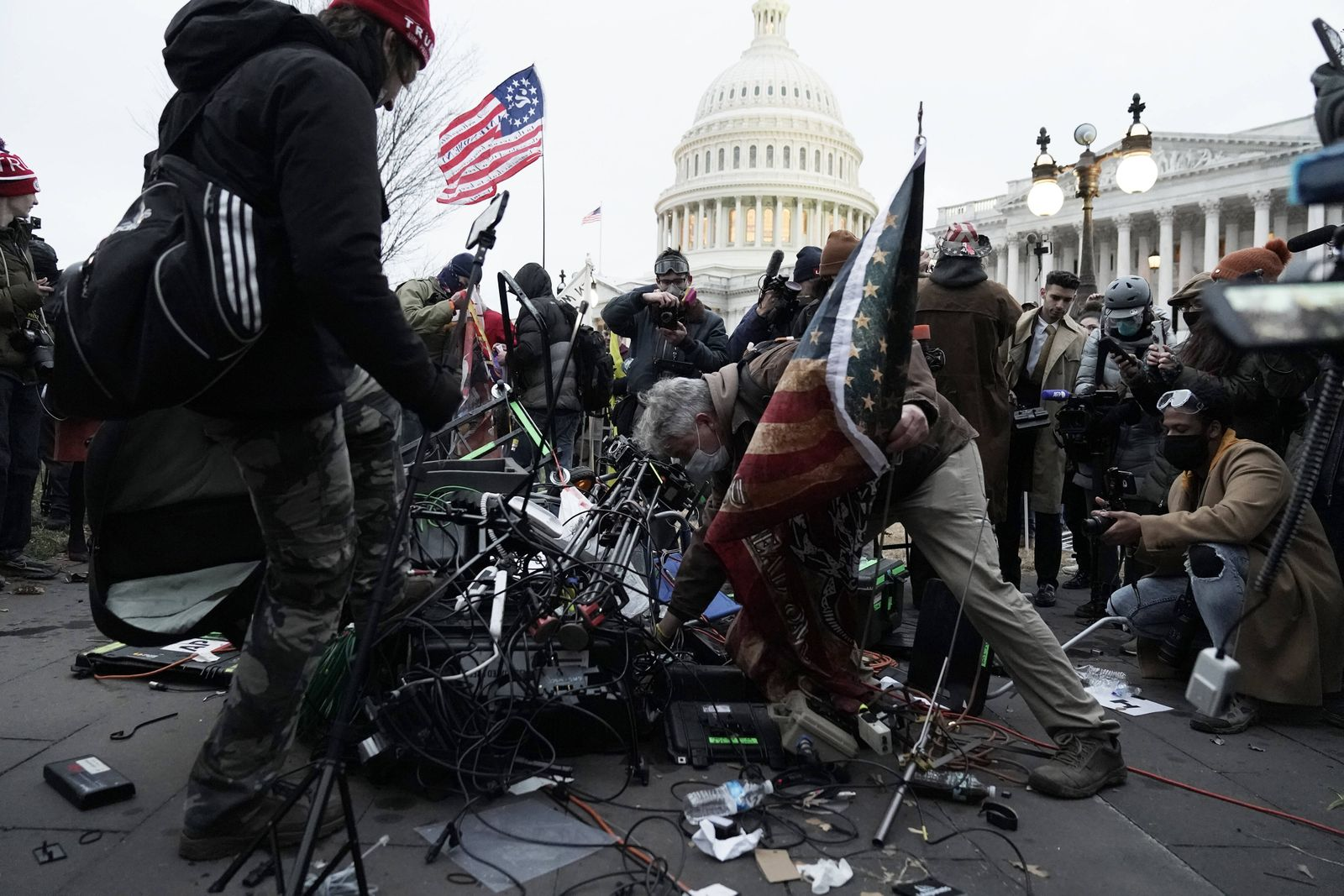 Pro-Trump rioters destroy camera gear and media equipment after breaching the security perimeter and penetrate the U.S.
