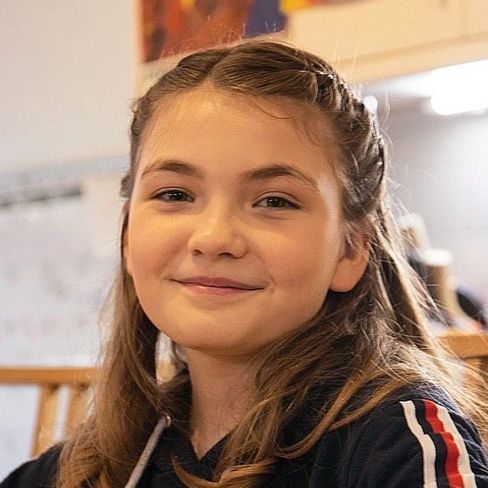 Ella, 11, spielt Kornett.