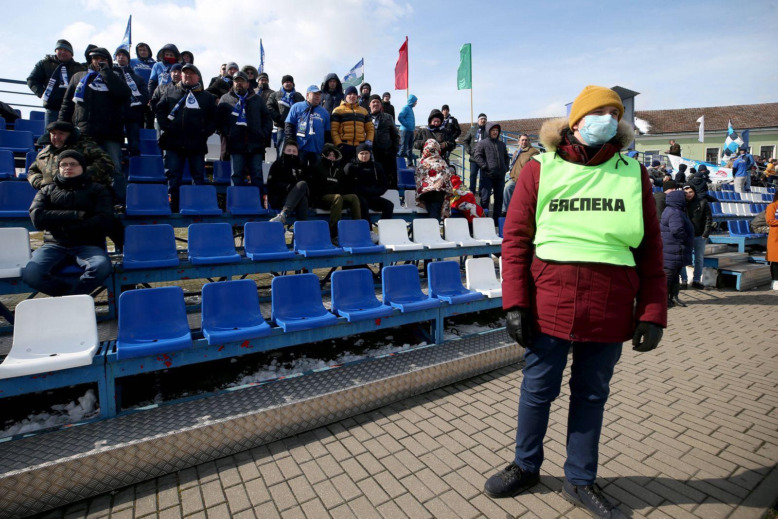 MINSK REGION, BELARUS - MARCH 22, 2020: Fans watch a 2020 Belarusian Football Cup match between FC Slutsk and Slavia Ma