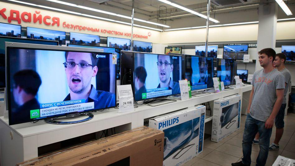 Snowden auf TV-Bildschirmen (in Moskau): Hoffnung auf Asyl