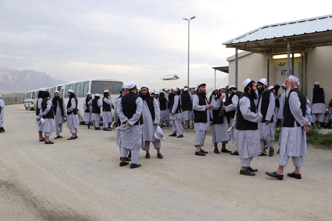 Newly freed Taliban prisoners chat with each other at Bagram prison, north of Kabul, Afghanistan