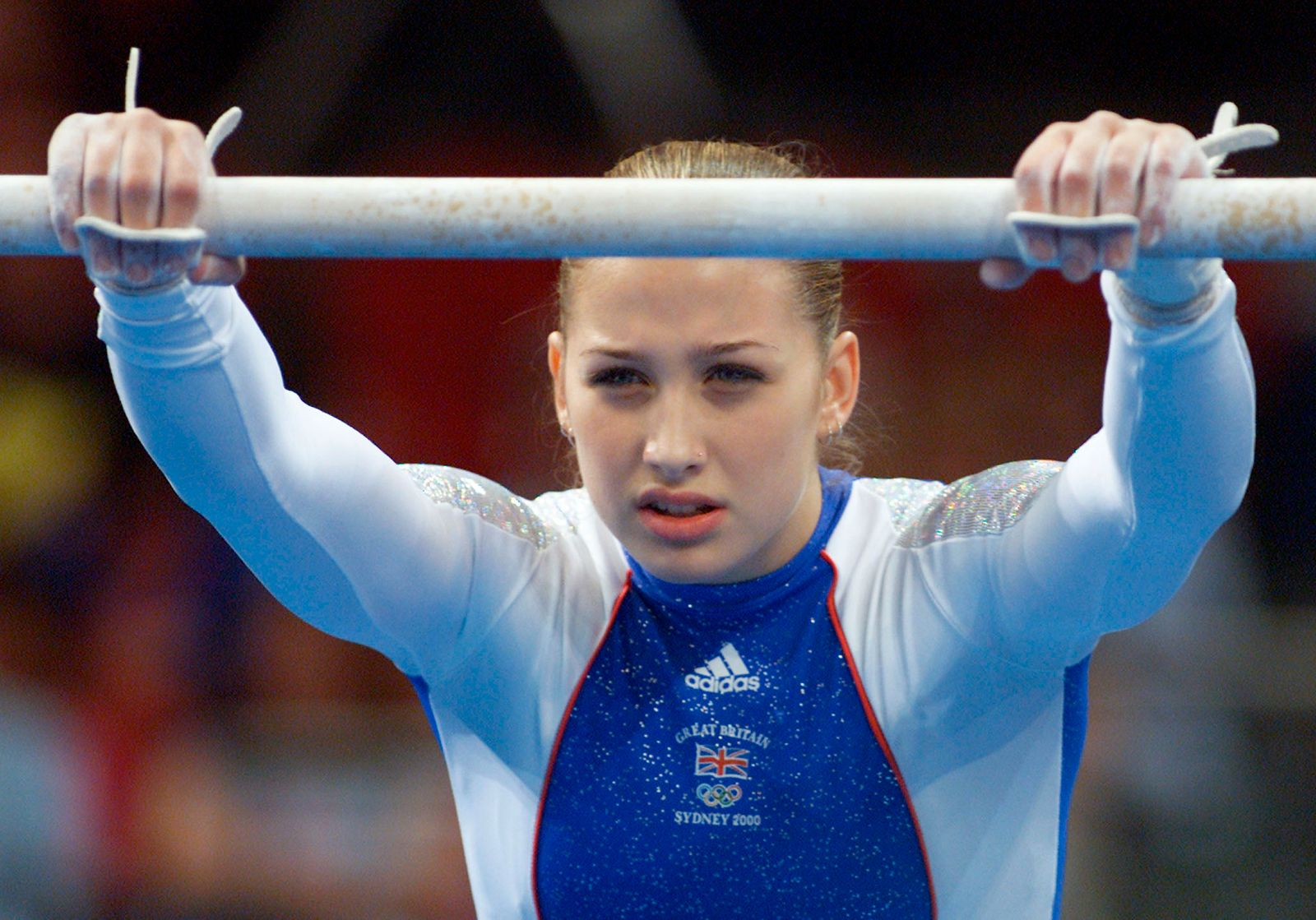GREAT BRITAIN GYMNAST LISA MASON LOOKS OUT FROM UNDER UNEVEN BAR.
