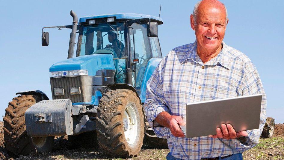 Landwirt mit Laptop
