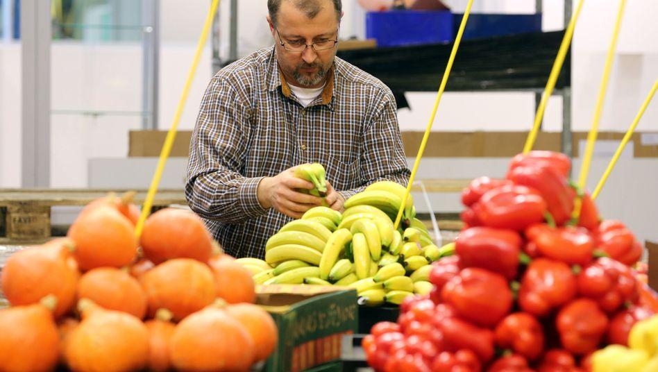 Verkäufer von Bioobst und -gemüse: Jeder kauft mindestens ein Ökoprodukt im Jahr