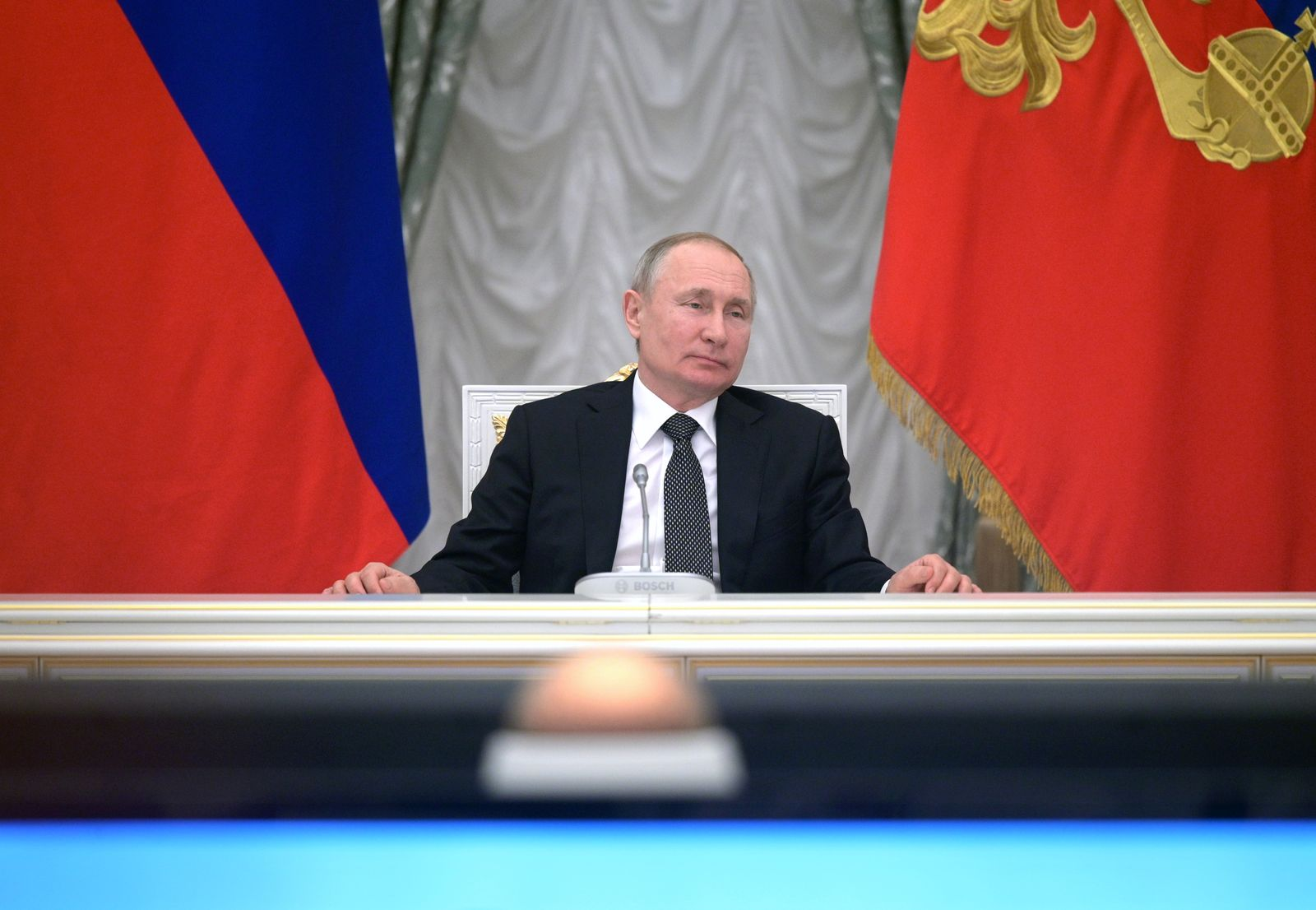 Russian President Vladimir Putin chairs a meeting with members of the working group on proposals for amendments to the Russian constitution, in Moscow