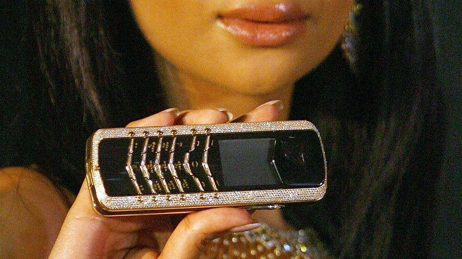 Diamantenbesetztes Handy: Kommunikationsmittel als Statussymbol