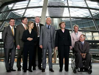 """Merkel's cabinet """"allies"""" from the CDU and CSU. Left to right, Maizere, Jung, von der Leyen, Seehofer, Stoiber, Merkel, Schavan, and Schäuble."""
