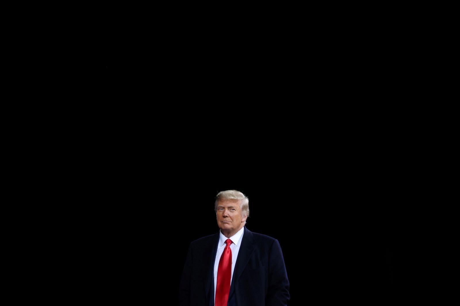 FILE PHOTO: U.S. President Trump campaigns for Republican U.S. senators Perdue and Loeffler during a rally in Valdosta, Georgia