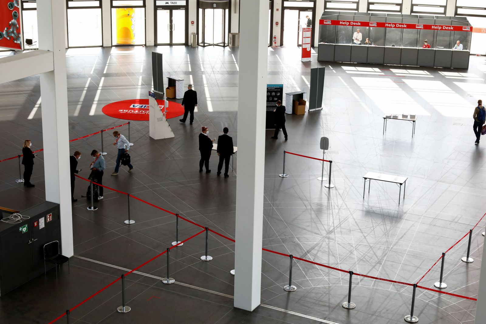 Visitors arrive at the IFA consumer technology fair, in Berlin