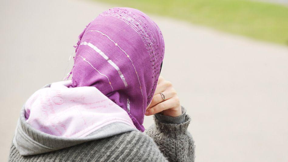 Frau mit Kopftuch: Die meisten Zwangsehen-Opfer stammen aus muslimischen Familien
