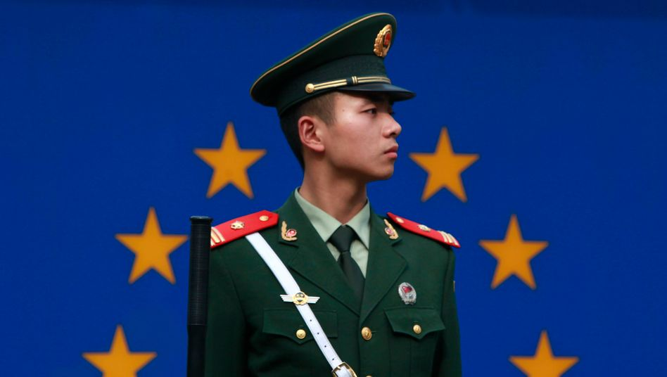 A Chinese policeman in front of the European Union flag in Beijing: Chinese investment in Europe could come at a price.