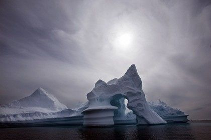 An iceberg melts off Eastern Greenland in this July 2007 file photo. Russia claims new soil samples show the Arctic is its.