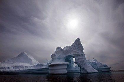 An iceberg melts off Ammassalik Island in eastern Greenland, July 2007.