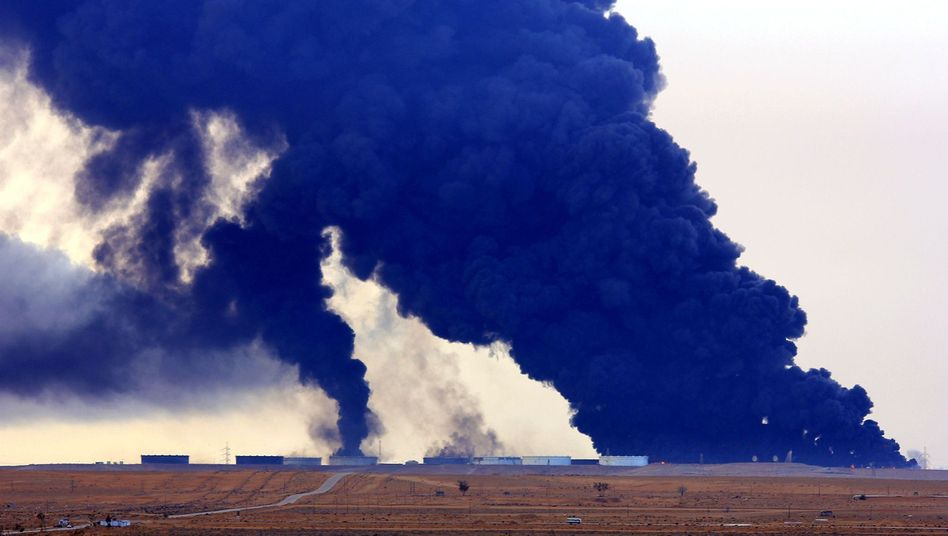 Heavy black smoke rises from an oil facility in Libya's Ras Lanouf region following an attack by the Islamic State last month.