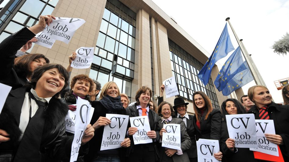Female members of the European Parliament protest against the male-dominated candidate list.