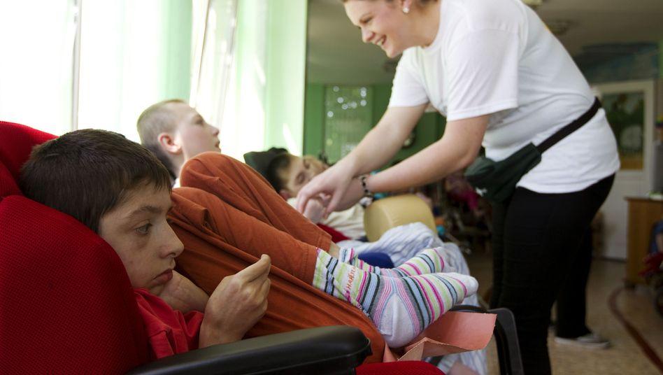 Pflege behinderter Kinder: Tücken des Sozialrechts