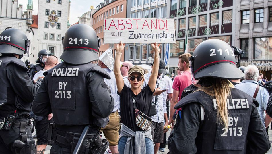 "A protestor in Munich: ""Distancing ourselves from forced immunizations."""