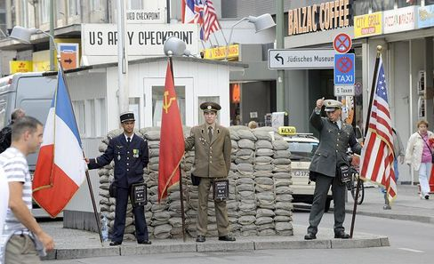 The presence of fake soldiers at Checkpoint Charlie charging €1 for photos has fuelled criticism that the legendary Cold War Site has become tacky.