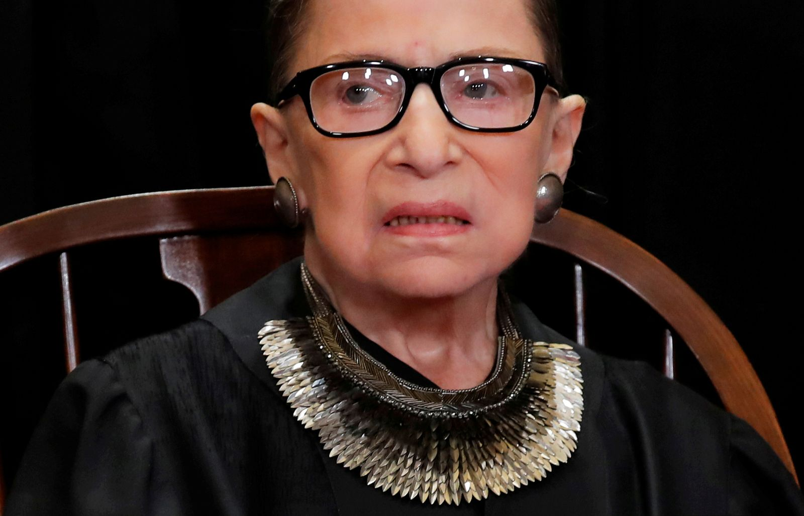 FILE PHOTO: U.S. Supreme Court Justice Ruth Bader Ginsburg poses during group portrait at Supreme Court in Washington
