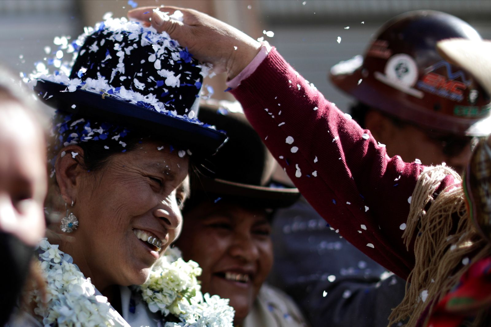 Hilda Condori, a deputy elect by the Movement to Socialism party (MAS) smiles during a rally a day after nationwide election in El Alto