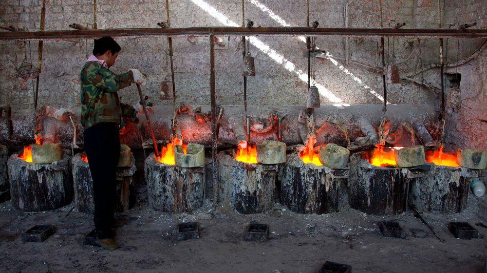Chinesischer Arbeiter: Gewinnung des seltenen Erdmetalls Lanthan