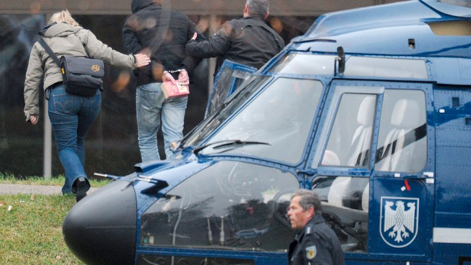Holger G. is seen on Nov. 14 as he is taken to the Federal Court of Justice in Karlsruhe.