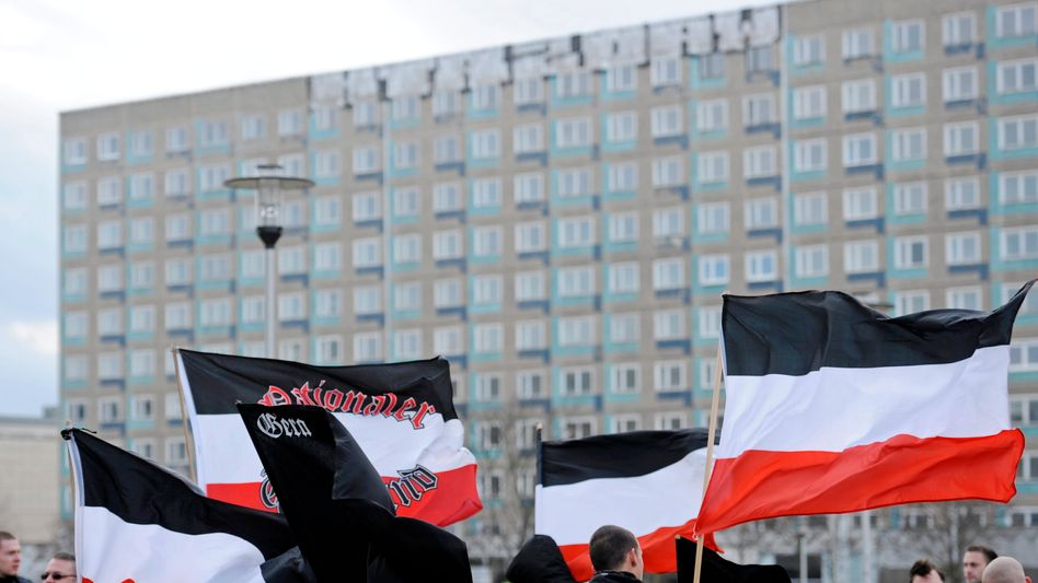 Far-right supporters take part in a rally organized by the neo-Nazi party, the National Democratic Party (NPD), in the eastern German city of Gera in this archive photo from 2011.