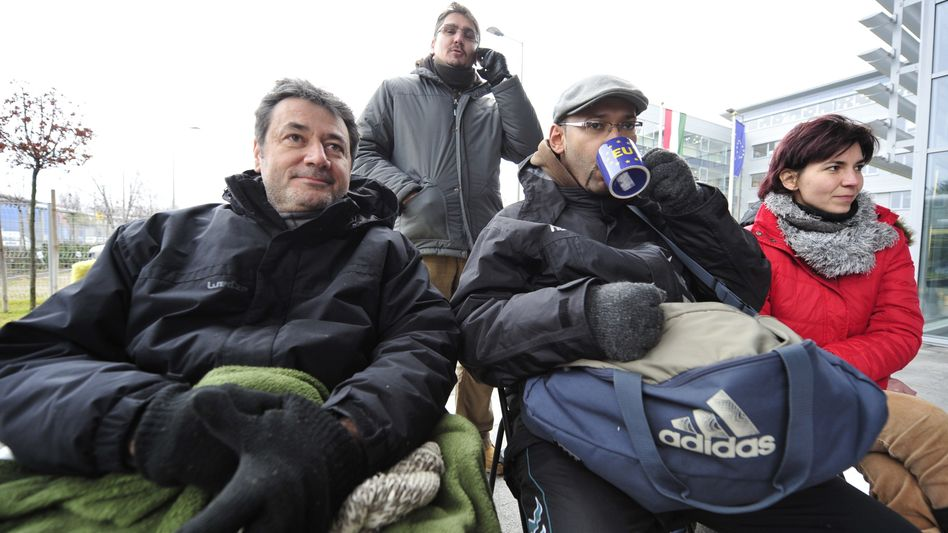 Hungarian journalists (from left) Balazs Nagy Navarro, Peter Virag, Sorel-Arthur Kembe and Aranka Szavuly on hunger strike outside the headquarters of Hungarian state television MTV in Budapest on Dec. 14.