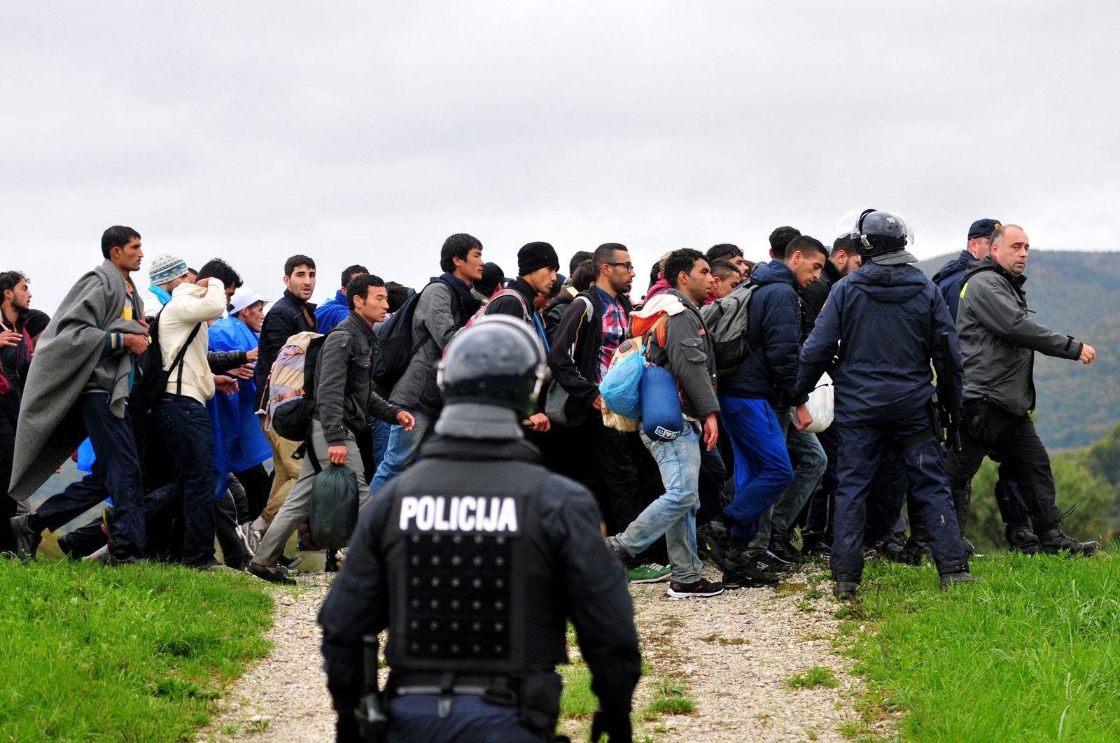 Migrants arrive in Slovenia after crossing the border with Croati